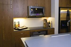 The kitchen includes EcoTop countertops and SilverWalker Studios' cabinetry.