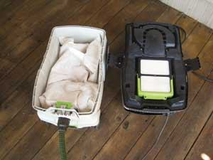 The motor and HEPA filter are housed in the upper part of the dust extractor. The fleece collection bag (shown here partially filled) sits inside the canister and is accessed by removing the top.
