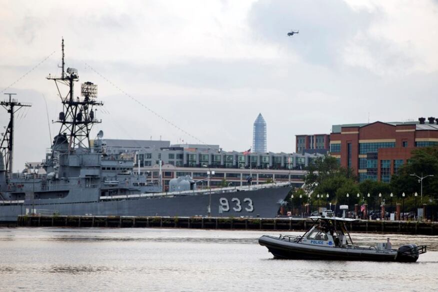 A police boat and helicopter patrol near the scene of a shooting at the Washington Navy Yard on Monday, Sept. 16, 2013, in Washington, D.C.