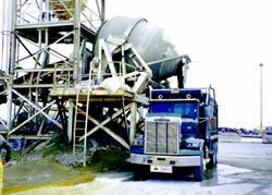 The stationary tilt drum mixer is fast, consistent, and suitable for most RCC  projects. Photos: Portland Cement Association