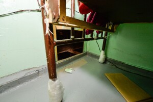 Hole cut through the steel at the back of one escapee's cell by unknown means.