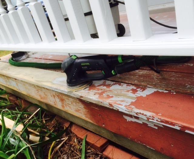 In most cases, power sanding isn't required to prep old decking for a new elastomeric coating; here, the author used it to  remove flaking and peeling areas in the finish.