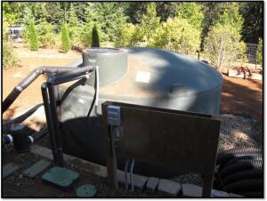 A 5,000-gallon storage tank in the back of the house holds roof runoff to be used for irrigation.