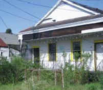"New Orleans' Ninth Ward was most devastated by Hurricane Katrina. Many houses stand abandoned, bearing the ominous ""X"" left by an agency that inspected them after the hurricane."