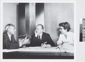 With the Seagram Building, Philip Johnson, Ludwig Mies van der Rohe, and Phyllis Lambert—tastemaker, designer, and benefactor, respectively (shown here, left to right, in 1955)—set the standard for the postwar office tower.