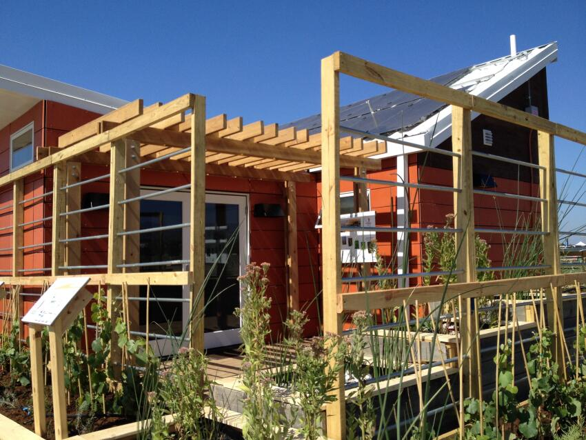 Phoenix House, constructed with steel trusses and SIPs, can withstand tornado speed winds.