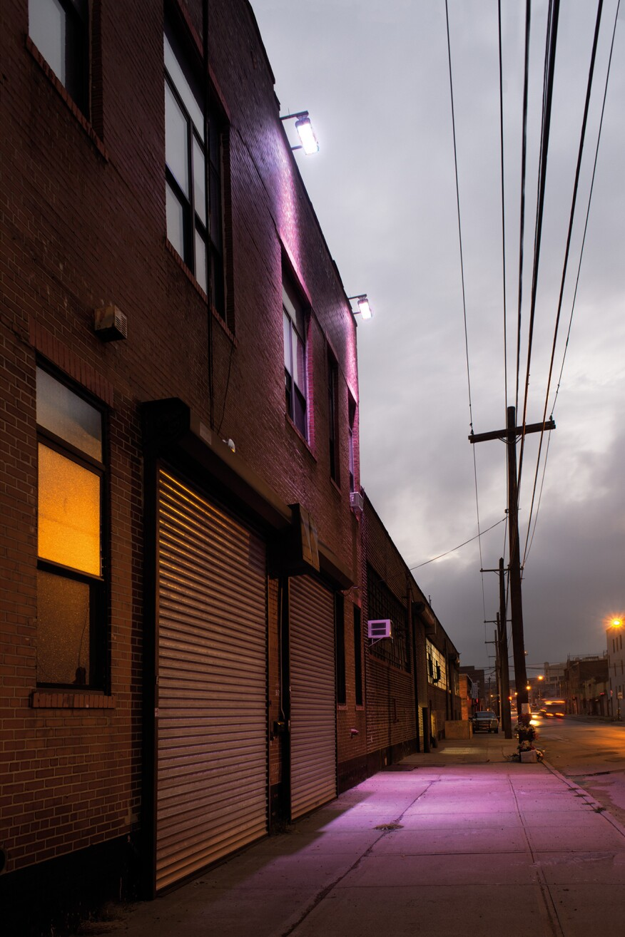 "Warehouses, Bushwick, Brooklyn, N.Y. ""Early one morning I visited Bushwick. The offbeat colored lighting seems to be part of the gentrification of this formerly industrial area."" -- Lynn Saville"
