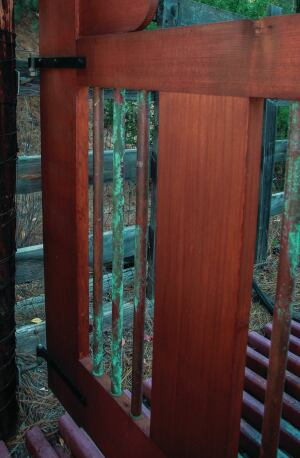 Prior to assembly, the copper balusters used in this garden gate (standard 3/4-inch-diameter Type-M copper tubing) were placed for about a week in a box containing sawdust soaked with a solution of muriatic acid and salt mixed with water.