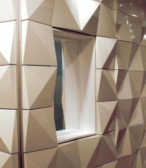 Graph modular interior wall systemFry Reglewww.fryreglet.com  Flexible aluminum grid system that adheres to existing wall systems - Prefabricated panels attach to the grid - Panels are available in a variety of metal finishes as well as four diff erent standard wood veneers - Designed in conjunction with Gensler