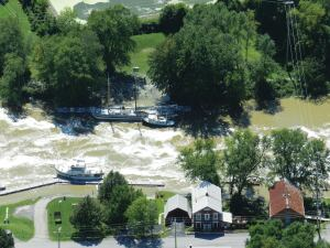 In August 2011, Tropical Storm Irene (called Hurricane Irene until it passed through New York City) flooded homes, uprooted trees, and destroyed roads and bridges in New England for two days.