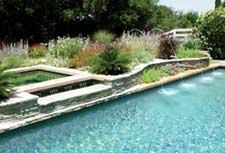 The Canvas: A swatch of lawn, a retro pool in need of renovationThe Palette: Earth tones with streaks of green, tiny spillways, a cover box hidden by flagstoneThe Masterpiece: Details, details, details; visual high jinks; understated water movement