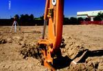 A magnetically mounted receiver indicates when the excavation is at grade with a green LED signal.