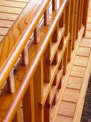 This rail design features a double top rail made of cedar and short upper balusters made from 3/4-inch diameter copper plumbing pipe.
