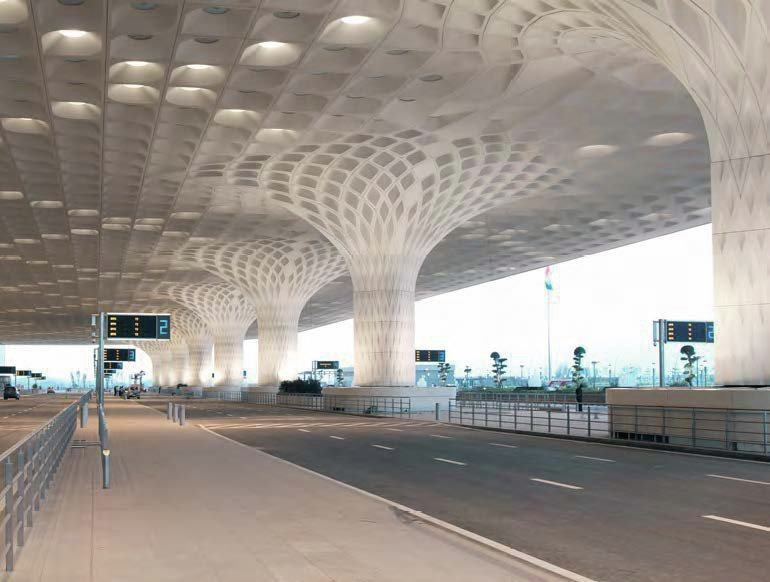 The airport's arrivals and departures area offers passengers shelter from rain, particularly during India's monsoon season. Though Formglas made the FRP molds for the exterior panels, a Chinese company fabricated the GFRC panels. Two 400-millimeter-diameter roof drains run down each exterior and interior column behind the panels.