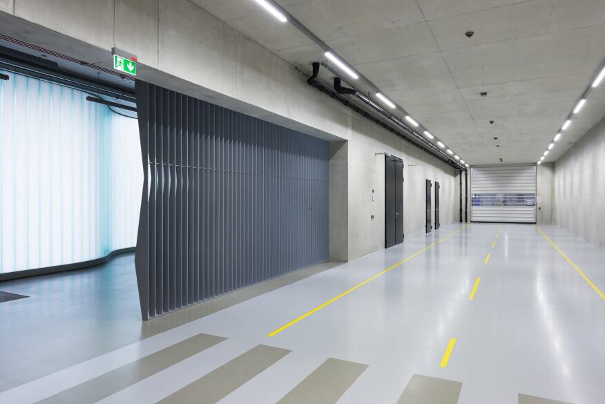 Factory corridor, showing metal fin and curved channel glass detailing