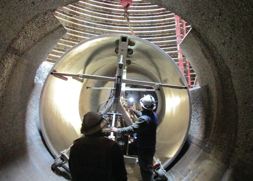 The pipe sections were carried into place and assembled inside the tunnel, much like a two-pass operation with the host pipe serving as the primary tunnel. The condition of the existing sewer made this the best installation method.