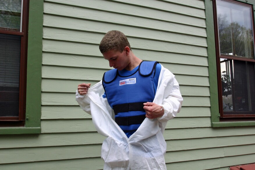 A cooling vest can make the experience of wearing disposable coveralls tolerable, if not enjoyable on a hot summer day.
