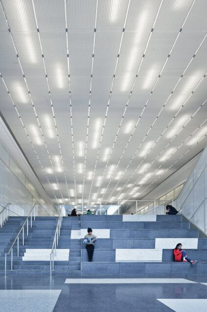 A random pattern of T5 fluorescent strip fixtures in varying lengths provide a whimsical yet practical amount of light.