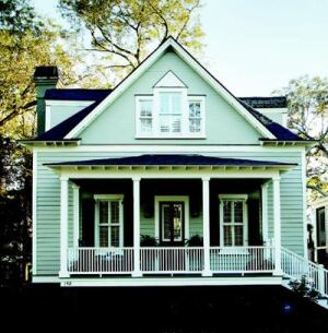 SMART PLANNING: Taking full advantage of its 37-by-109-foot lot, Structures Building Co. designed the back of this 1,400-square-foot house in Mount Pleasant, S.C., as a connector between the cottage-style front elevation and a separate two-story garage at the back of the lot.
