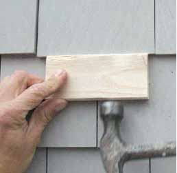 Figure 9. To blind-nail a replacement shingle, hold it slightly below its intended location and nail it just below the butt line of the course above. A few taps with a block and a hammer drive the shingle into place, bending the nails mostly out of sight at the same time.