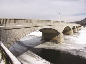 """ACI 562 can serve as a valuable reference for the unique considerations of repair projects, such as the restoration of this historic, reinforced-concrete-filled arch bridge. The code is """"applicable to existing concrete structures, including the concrete elements of buildings, nonbuilding structures when required by the building official, building foundation members, soil-supported structural slabs, concrete portions of composite members, and precast concrete cladding that transmits lateral loads to diaphragms or bracing members."""""""