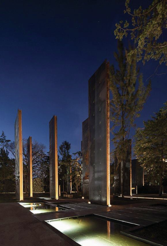 At the center of the Memorial site, a series of steel walls are integrated with reflecting pools.