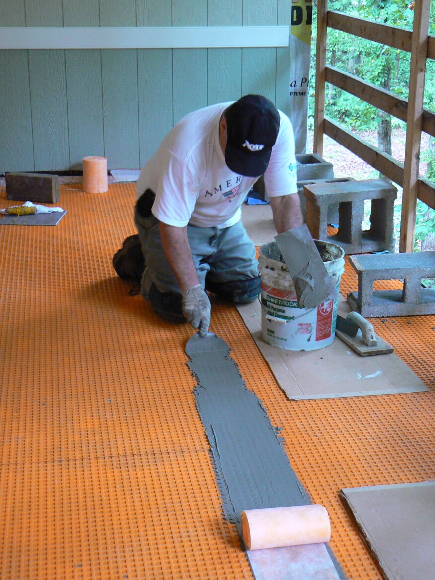 The author taped the membrane seams with 5-inch Schluter Kerdi-Band embedded in unmodified thinset. The process of taping these seams is a lot like that of taping drywall seams and can be done with the same tools.