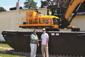Mark Allonardo (left) from JCB's southern New Jersey dealership Farm-Rite Inc. and Edward Sokorai of the Cape May County Department of Mosquito Control.