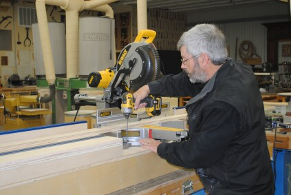 Extra space can be left to help with cutting crooked boards. Drive screws through each saw foot to hold it in place.