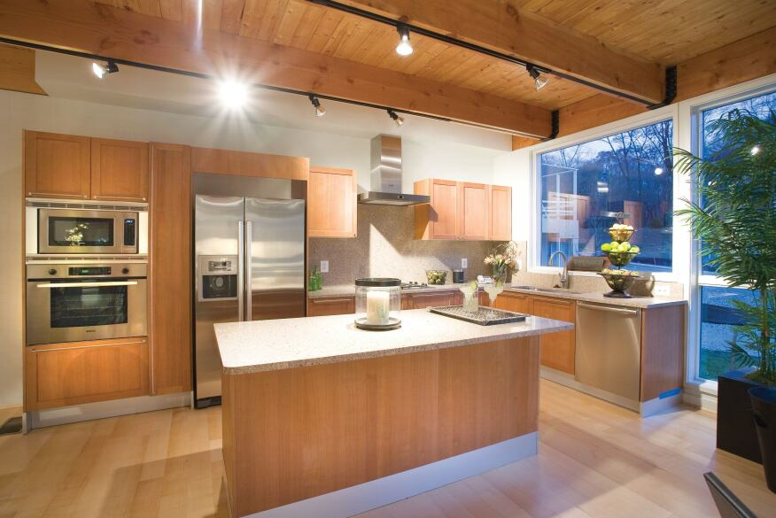 Paint To minimize off-gassing, the homes feature Builders Masterpiece low- or no-VOC interior latex finishes by Duron Paints. The products have a minimum amount of odor and a non-yellowing formula. 800.723.8766. www.duron.com. Cabinets Formaldehyde-free Valcucine cabinets use up to 80% less material than traditional cabinetry, are made with FSC-certified wood, and are finished with nontoxic citrus oil. The wood-laminate doors are highly resistant to humidity and heat. The Cristalite worktops offer 100% antibacterial properties because of the presence of silver ions. 212.253.5969. www.valcucinena.comAppliances The homes feature Bosch kitchen appliances, including the Energy Star–qualified Evolution 500 Series refrigerator and the Energy Star–rated Integra 300 Series dishwasher. The dishwasher's energy-saving elements include EcoSense, which adjusts water according to soil levels, reducing energy use by up to 20%. 800.944.2904. http://www.boschappliances.com./Flooring FSC-certified Kährs hardwood floors consist of parquet boards bonded together side by side, not to the underfloor. The Mega Strip Flooring series (4-inch boards) show off bright mineral streaks and a minimum amount of knots. 800.800.5247. www.kahrs.com.