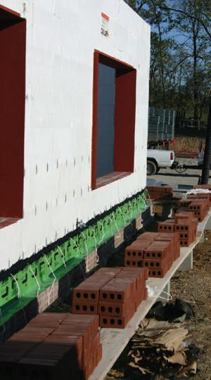 These integrated window assemblies installed prior to concrete placement stand ready for the brick facing.