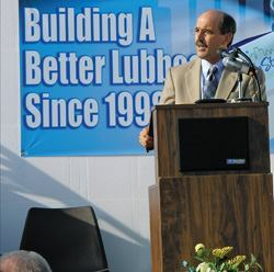 Patrick Murphy addresses the crowd at a ceremony celebrating the 100th insulating concrete form (ICF) home built in Lubbock, Texas.