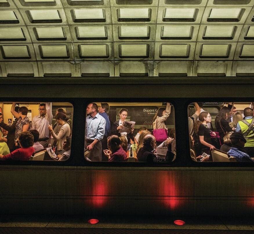 Commuters on a red line train at Dupont Circle.