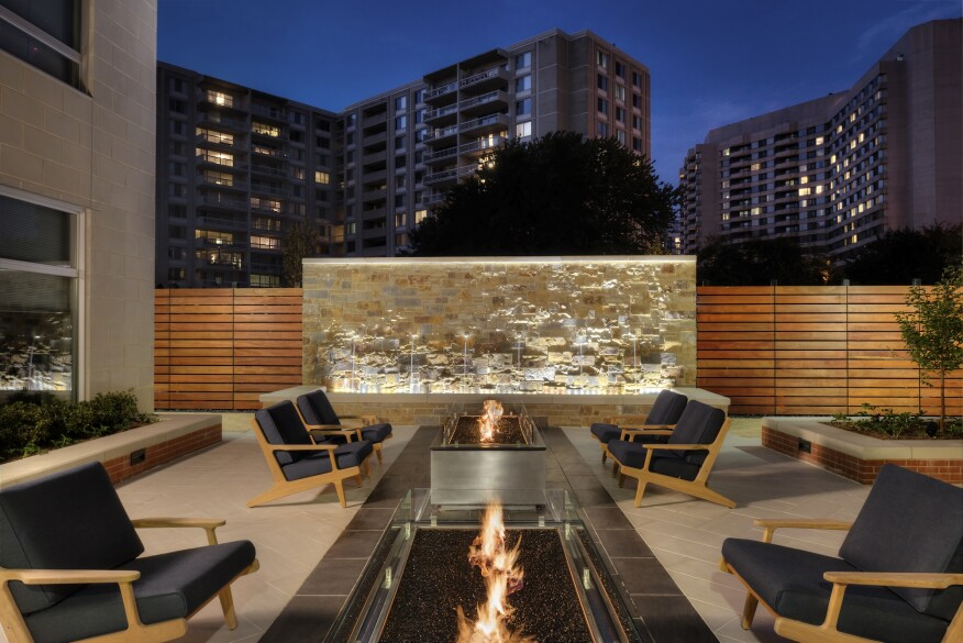 outdoor fireplace, fountain, courtyard, amenities, mid-rise
