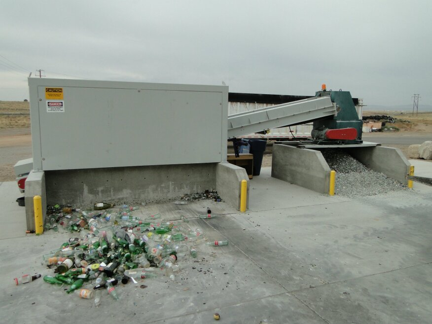 There are two types of crushing: impact and compression. The Village of Los Lunas owns two impact crushers. One is a manually fed vertical-shaft impact (VSI) machine that processes 40 glass bottles a minute; the other, a conveyor-fed horizontal rotary plant that processes more than a ton per hour.
