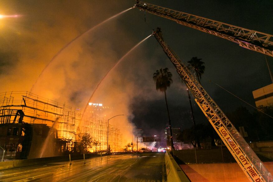 An under-construction, unoccupied apartment building in Los Angeles caught fire on Monday morning. According to theLos Angeles Times, officials reportthat the fire destroyed two-thirds of the 1.3 million square-foot structure, and harmed two nearby buildings.
