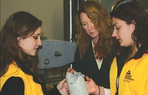 Carter (center) works with two of her students in the concrete industry management program.