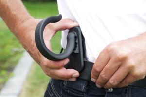 Slide-Kick hose and cord holder