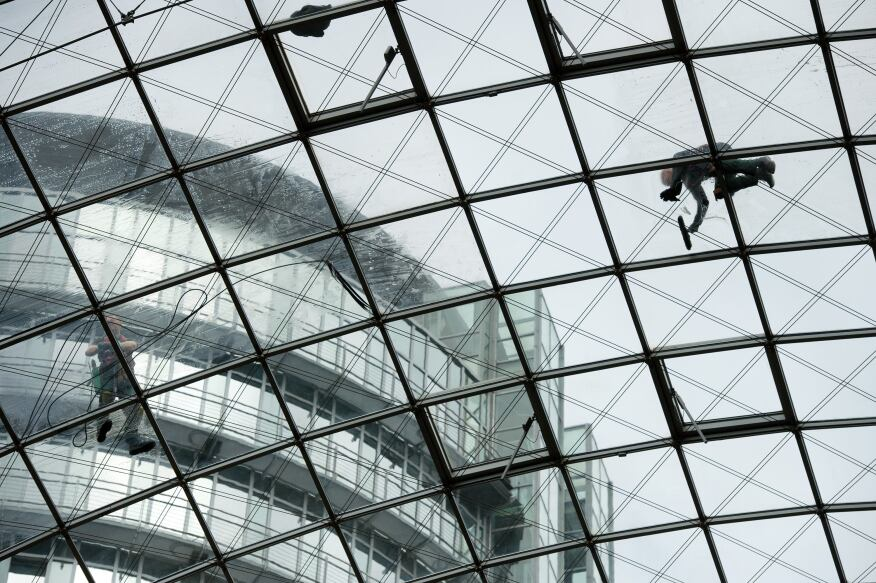 Window cleaner Michael Lehmann works on the roof of Dresden, Germany'sWorld Trade Center.