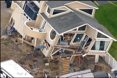 Sandy-Damaged House Destroyed in Fall From Cribbing