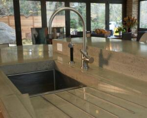 A highly flexible material, concrete can be used to create colorful countertops with a variety of planes and surfaces. This top by Sean Dunston has integrated drainboards set right into the top.