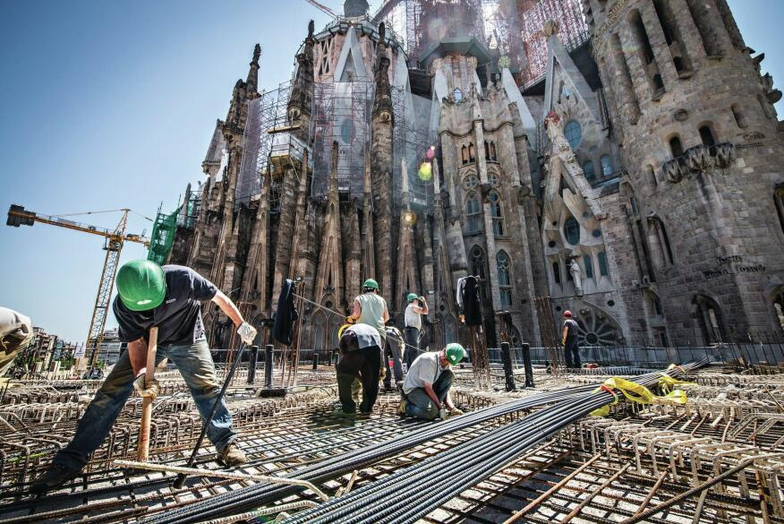 Workers reinforce the project site to accommodate the anticipated construction of new structures, such as the Glory façade at the project's south entrance, as well as towering additions to the existing structure.