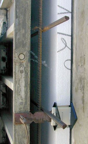 Wall-Ties system insulation can be placed either inside or outside a foundation wall. The plastic diamonds inserted through the form ties hold the insulation in place during concrete placement.