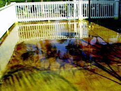 Crews applied a chemical acid stain to Outback Steakhouse outdoor area to give it an attractive, rustic appearance.