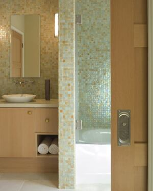 Banducci looks to Oceanside Glasstile's Tessera mosaics when he wants to add pizzazz to his baths, including the one shown here. The tiles are made from silica sand and, in some cases, post-consumer recycled bottle glass. A fan of the products' durability
