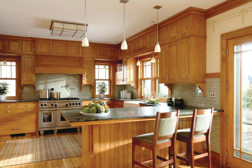 The Facts of Light  All of the lighting in the revamped kitchen was designed by David Heide Design Studio and fabricated locally by Lightworks. This ensures that clients get a unique product and wonít see the same fixtures elsewhere.    The historic language of the existing house inspired the scale, size, and proportions of the addition as well as the character of the finishes. By adding on to the back of the house and switching the locations of the dining and family rooms, the designers were able to elevate the status of the kitchen.