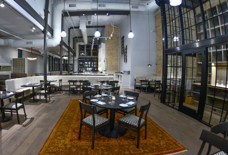 """Designers conceptualized the restaurant's open kitchen as a """"theater"""" of sorts."""