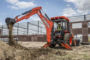 The Kubota M62's backhoe boasts a 14-foot maximum digging depth, making it an attractive option to buyers in the construction and utility sectors.