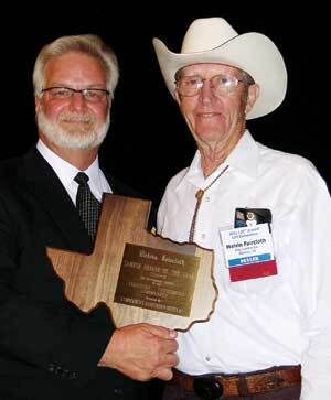 Texas Proud: Robert Archer, then-president of the Lumbermen's Association of Texas and Louisiana, gives LAT's dealer of the year award to Melvin Faircloth of City Lumber, Abilene.