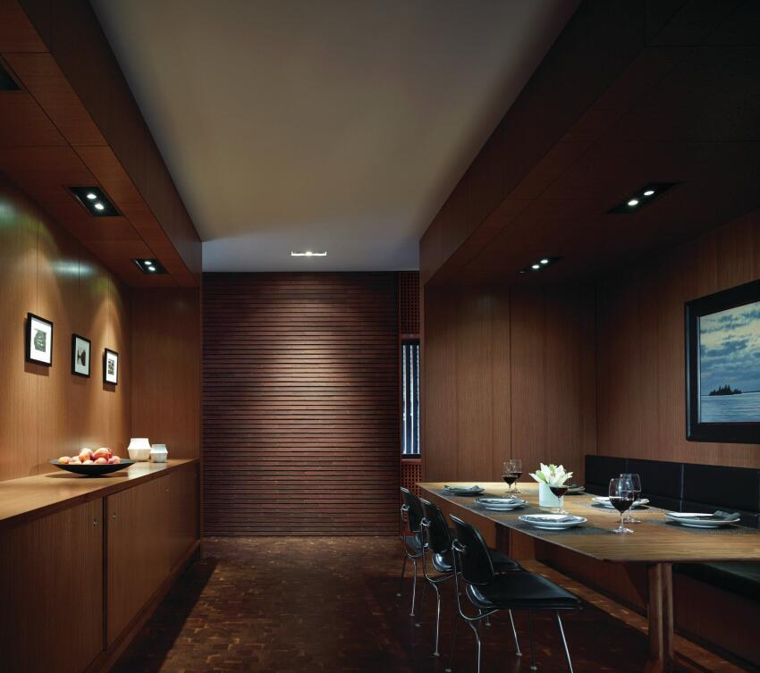 In the dining room, Pyrok's Star Silent acoustical plaster ceiling system contrasts with the warm wood veneer wall panels from the Veneer Specialists.